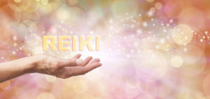 golden-reiki-healing-energy-share-female-outstretched-hand-palm-facing-up-word-hovering-above-ethereal-bokeh-62931037